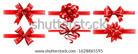 Realistic red ribbons with bows. Festive wrapping bow, gift decoration and presents ribbon vector set. Bundle of elegant shiny satin tapes. Set of glossy textile strips isolated on white background. Royalty-Free Stock Photo #1628865595