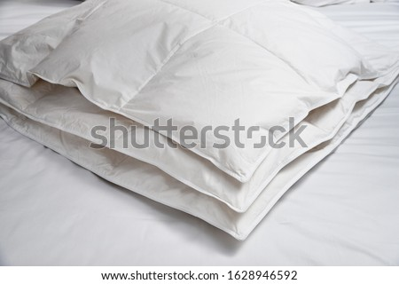 White blanket (quilt) on the bed #1628946592