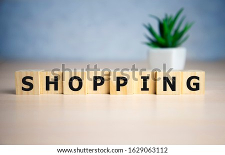 Shopping word, word cube with blue background. #1629063112