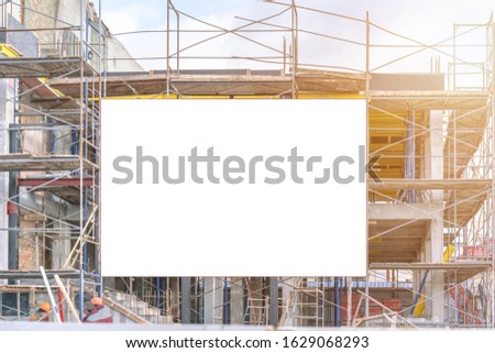 construction site with scaffold and building with housing background at town street mock-up