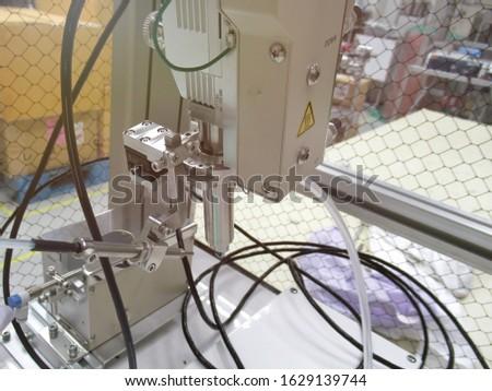 Solder robot, Robotic soldering used in soldering PCB board, close up. #1629139744