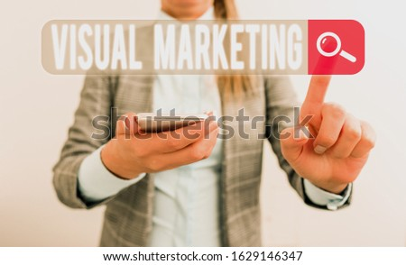 Text sign showing Visual Marketing. Conceptual photo telling the story of your brand or product by creation Business concept with mobile phone and business woman.
