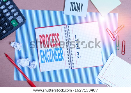 Writing note showing Process Engineer. Business photo showcasing responsible for developing new industrial processes Striped paperboard notebook cardboard office study supplies chart paper. #1629153409
