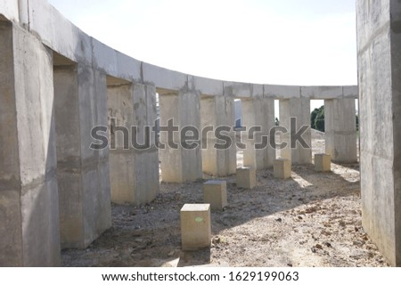 archaeology space time teller with architecture concrete structural wall columns in one day. It works with sunlight to reflect and appear the shadow on the floor as a clock when looking from above. #1629199063