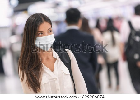 Virus mask Asian woman travel wearing face protection in prevention for coronavirus in China. Lady walking in public space bus station or airport. #1629206074
