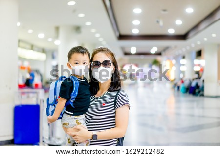 Coronavirus covid-19 concept.Little chinese boy with mother wearing N95 mask for protect from coronavirus for back to school.School kid go to school with mom.New normal lifestyle post coronavirus. #1629212482