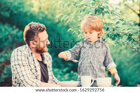 Father teach son eat natural food. Little boy and dad eat. Organic nutrition. Healthy nutrition concept. Nutrition habits. Family enjoy homemade meal. Personal example. Nutrition kids and adults. #1629292756