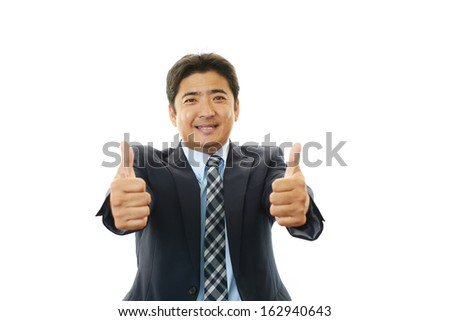 Happy business man showing thumbs up sign #162940643