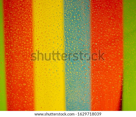 Perfect picture of drops of water on multicolors background