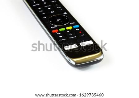 TV remote control, black plastic cover with colored buttons and white buttons, on and off, remote control, remote control, home range, home furnishings  #1629735460