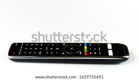 TV remote control, black plastic cover with colored buttons and white buttons, on and off, remote control, remote control, home range, home furnishings  #1629735691