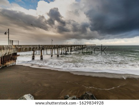 Cloudy Pacific Pier on the Pacific Coastline #1629834928