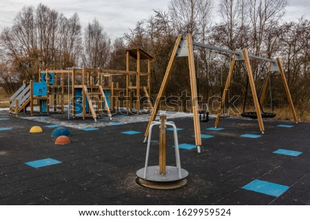 Children's playground with artificial cover, slide and swing. Leisure time, Healthy, active lifestyle #1629959524