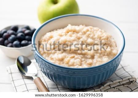 Healthy breakfast oatmeal porridge in bowl. Warm porridge oats, vegan vegetarian weight loss dieting breakfast food #1629996358