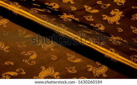 Texture background pattern Yellow mustard brown chiffon fabric with paisley print High quality pure silk chiffon fabric bright beautiful color combinations This fabric is suitable for design wallpaper #1630260184