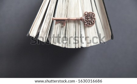 Old key with bible. Concept of wisdom and knowledge #1630316686