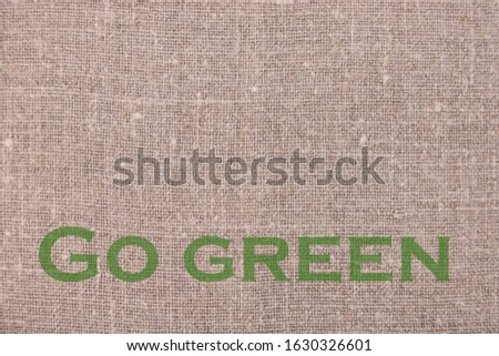 Go green message on linen natural background. Ecology protection concept. #1630326601