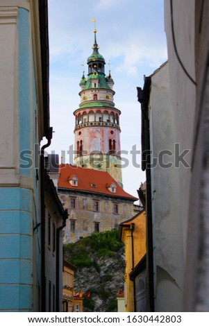 Vertical picture of the Castle Tower in State Castle between buldings, the most famous symbol of Cesky Krumlov, Czech Republic