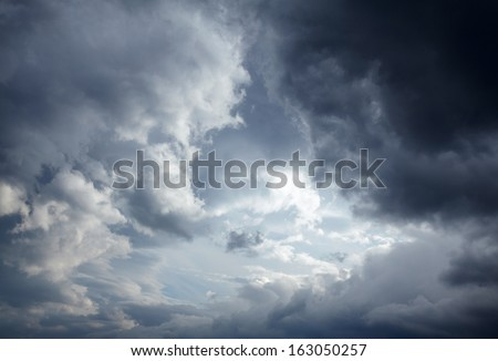 Dark storm clouds background Royalty-Free Stock Photo #163050257