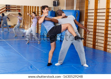 Males training attack movements in pair at self protection workout #1630529248