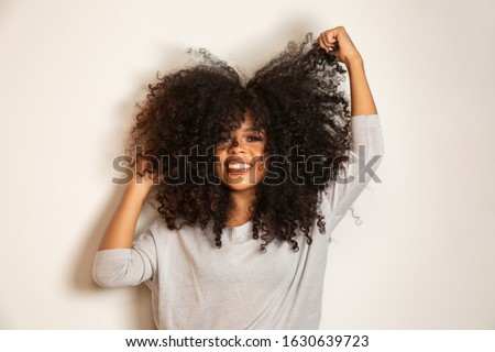 Beauty portrait of african american woman with afro hairstyle and glamour makeup. Brazilian woman. Mixed race. Curly hair. Hair style. White background. Royalty-Free Stock Photo #1630639723