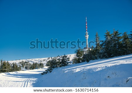 Praded's television transmiter in winter with view of cross country skiing trail and landscape covered in snow.  #1630714156