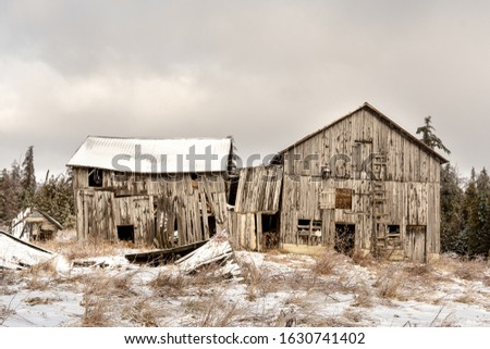 The derelict and abandoned barn on the property of an abandoned house in ontario canada Royalty-Free Stock Photo #1630741402