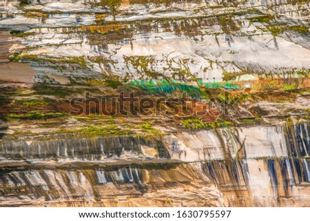 This beautiful bright vibrant nature picture of a rock wall was taken on a boat cruise from Munising City Dock of the Pictured Rocks National Lakeshore located in the Upper Peninsula, Michigan