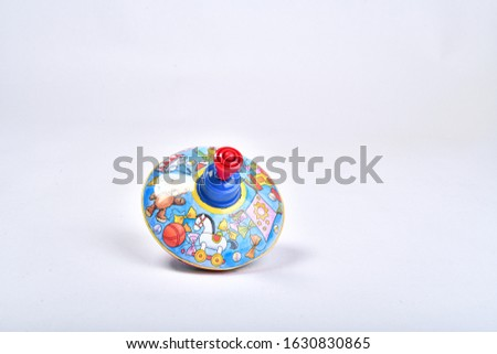Toy Yula with pictures on a white background.spinning top