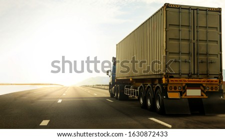 Cargo Truck on highway road with container, transportation concept.,import,export logistic industrial Transporting Land transport on the expressway againt sunrise sky #1630872433