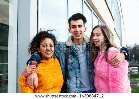 cute group of teenages at the building of university with books huggings, diversity nations real students lifestyle #1630884712