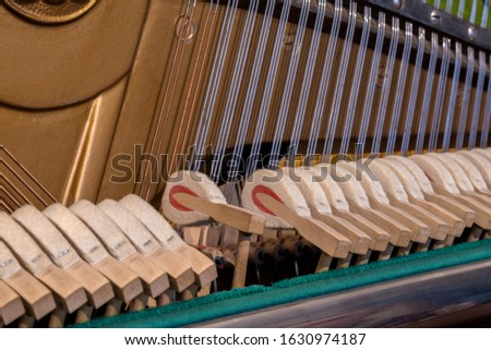 Inside the piano - button and string settings. Beautiful lines of strings, parallels. #1630974187