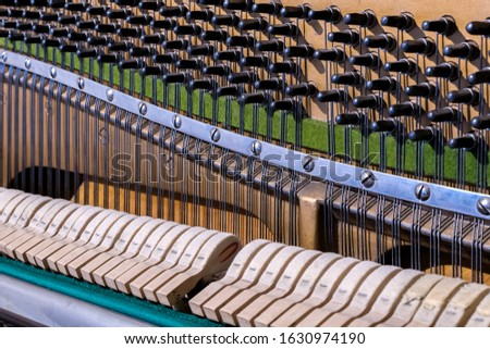 Inside the piano - button and string settings. Beautiful lines of strings, parallels. #1630974190