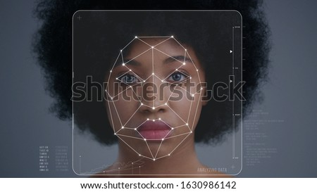Face Detection. Face ID. Facial Recognition System Concept. Technological 3D Scanning of Face of Pretty Afro-American Woman for Biometric Facial Recognition. Animation with Dots and Trackers on Human #1630986142