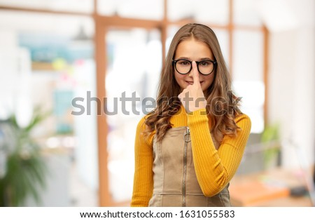 high school, education and vision concept - smiling teenage student girl in glasses over classroom background