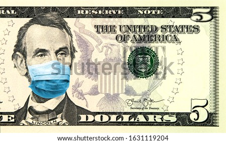 Coronavirus panic in United States. Quarantine and global recession. 5 American dollar banknote with a face mask against infection. Global economy hit by corona virus pandemic. Montage. Concept Royalty-Free Stock Photo #1631119204