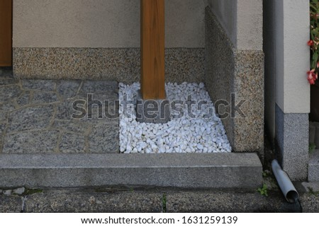 architecture column foundation design. pebble cover at ground level and granite stone foundation for moisture and wetness control. detail design separating wood and dirt floor.  #1631259139