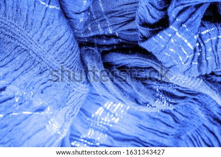 The texture of the background picture, the ornament of the decor, sapphire blue corrugated fabric, fabric with parallel or diagonal folds with serrated folds; products from such a fabric. #1631343427