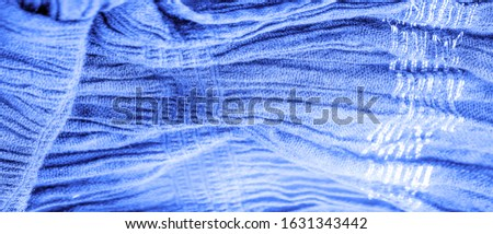 The texture of the background picture, the ornament of the decor, sapphire blue corrugated fabric, fabric with parallel or diagonal folds with serrated folds; products from such a fabric. #1631343442