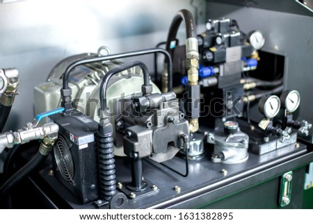 Motor and hydraulic pump to build complex technical systems Royalty-Free Stock Photo #1631382895