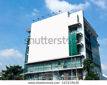 Blank billboard on the building. Useful for your advertisement.