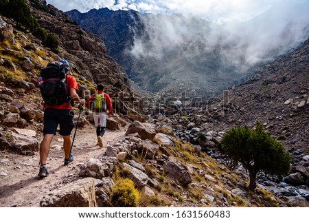 Hiking to the summit of Jebel Toubkal, highest mountain of Morocco. Royalty-Free Stock Photo #1631560483