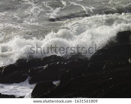 The wild Irish sea mid winter on a cold and windy day #1631561809