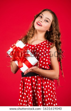 Womens day. Surprise for pinup girl. Retro party. Retro girl present wrapped box. Happy valentines day. Birthday gift box. Shopping sales. Adorable child consumer red background. Fashion clothes. #1631619040