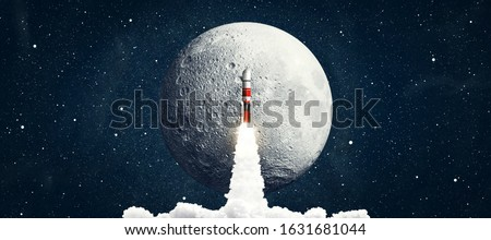 Rocket launching in space sky with stars. Elements of this image furnished by NASA #1631681044