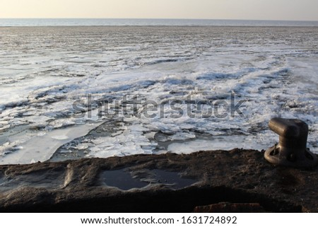 beautiful frozen White lake and ice on a Sunny day in autumn #1631724892