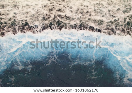 The strong wave of blue sea water that falling down to lower floor, looking from top view. #1631862178