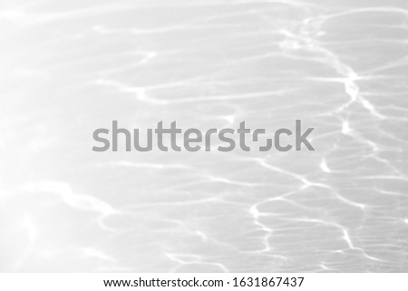 Water texture overlay effect for photo and mockups. Organic drop diagonal shadow and light caustic effect on a white wall. #1631867437