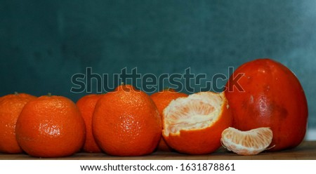 Ripe tangerines and ripe persimmon for dinner #1631878861