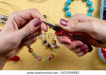Jewelry making. Production bracelets and necklaces from multi-colored beads. #1631904883